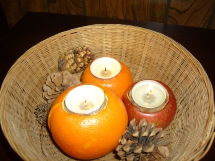Hollowed out fruit with allspice for natural holiday air freshener