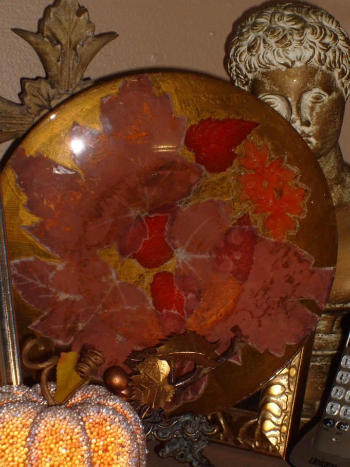 Fall motif made with glass plate, silk flowers and tissue paper