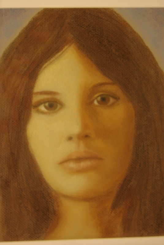I prefer using pastels for portraits.  There is a greater control over it.