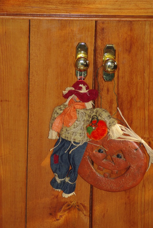 Wacky clay pumpkin and scarecrow dangle from a hutch a friend of mine made.