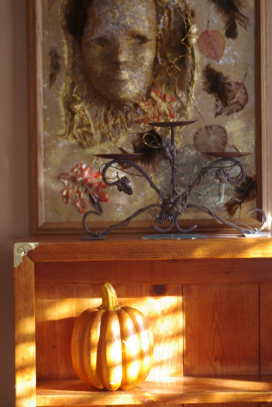 Another view of hutch shows a pumpkin and part of my mixed media art using masks.