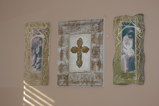 I purchased the two end pictures to go with the cross I painted years ago.  Makes a nice set.