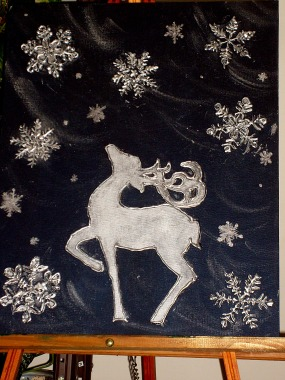 Deer silhouette with snowflakes, enhanced with glue and painted.