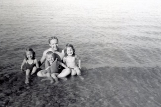 Dad with me, my sister and my oldest brother probably in Lake Erie somewhere.