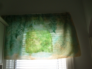 Valance with tea stained mulsin, transfers, paint and stitching.