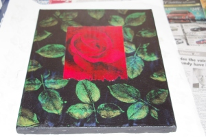 Stamped metalic rose leaves with red rose transfer.