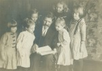 My aunts with dad reading to others