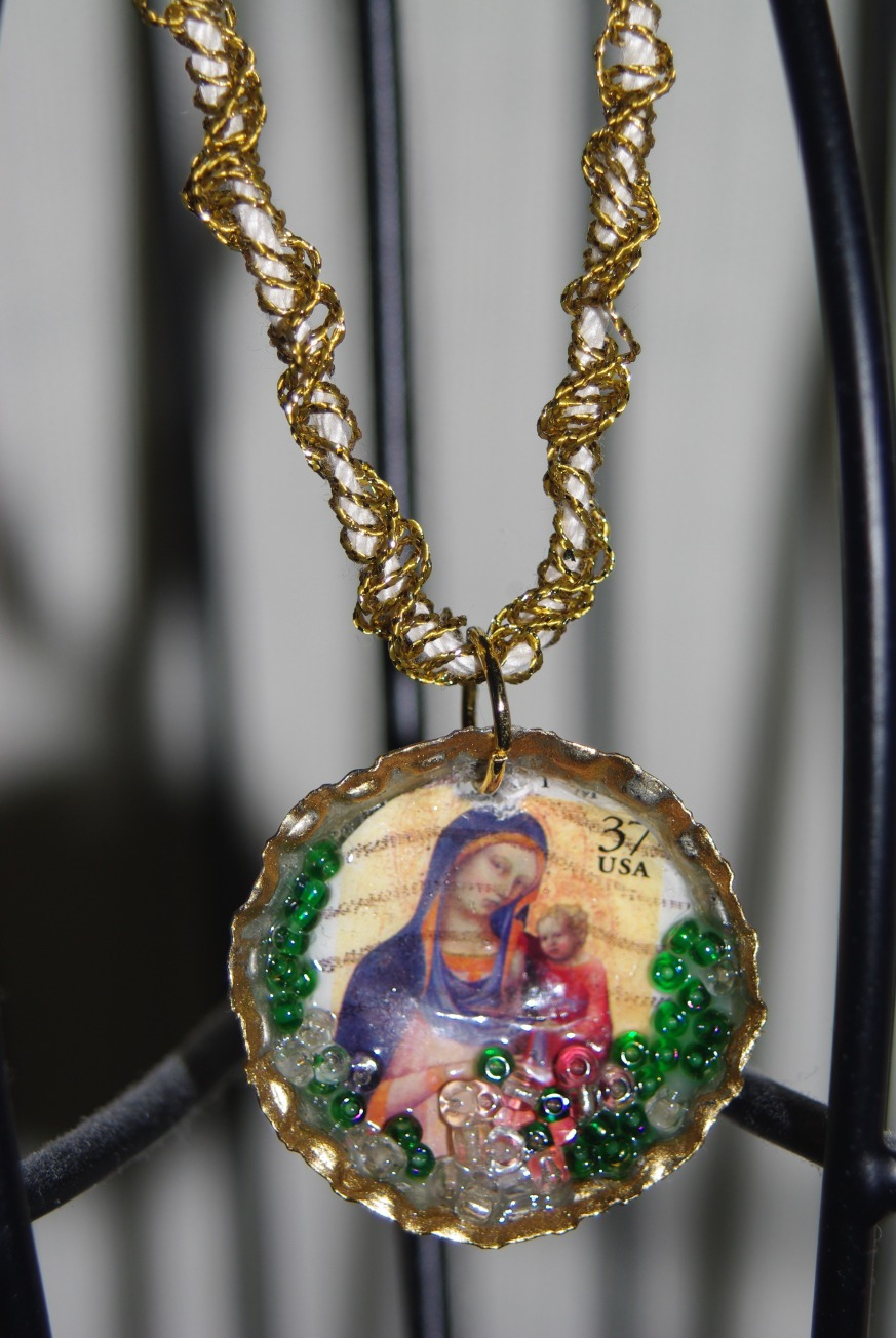 Mixed media art jewelry from an old postage stamp & bottle cap.