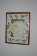 Rose transfer in center of large plexiglass with stamped border.